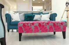 """This loud ottoman is upholstered in our """"BELL"""" fabric, a beautiful cut velvet with hot pink raised leafs on a grey background."""