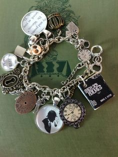 Sherlock Holmes Charm Bracelet I need to wear more charm bracelets. My wrist tattoos are high up so I can! Sherlock Holmes, Sherlock 3, Jewelry Box, Jewelry Accessories, Geek Jewelry, Gothic Jewelry, Vintage Jewellery, Antique Jewelry, Jewelry Necklaces