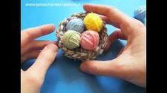 Decorazioni di Pasqua fai da te: nido e ovetti di lana, via YouTube.