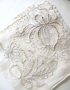 White on white embroidery & cutwork design. You don't see much of the latter these days.
