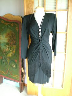 This black fringed wrap dress is EXACTLY  what I want.