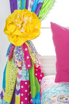 Want to punch up the cute factor in your little sweetie's bedroom? A bright-as-can-be three-layer rosette will get you there.
