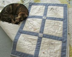 Kitten quilt, guarded by our monster cat, Travers!