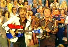 Hee Haw (1969–1997)  Cast and history: http://www.imdb.com/title/tt0063908/?ref_=fn_al_tt_1  Theme music: http://youtu.be/PKmmjDX1oSs