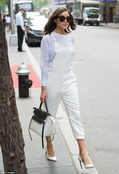 Radiant and solo: Olivia Culpo took to the streets of Manhattan on the same day while looking stylish in white overalls and pumps
