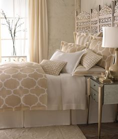 bed colors...love the folding screen headboard...I just so happen to have a screen I need to find a place for