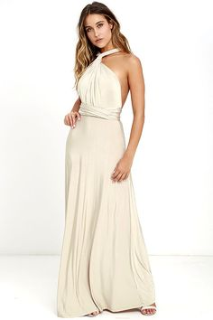 """Any which way you wrap it, the Always Stunning Convertible Beige Maxi Dress is one amazing dress! Two, 83"""" long lengths of fabric sprout from an elastic waistband and wrap into dozens of possible bodice styles including halter, one-shoulder, cross-front, strapless, and more. Stretchy beige fabric has a satiny sheen, and a full length maxi skirt pairs perfectly with any choice you make up top. Want Styling Tips? <a href='http://bit.ly/HowToWearIt' target&#x..."""