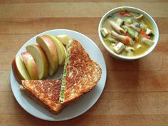 Apples, grilled avocado, green bell pepper, and onion sandwich on whole wheat with vegetable soup
