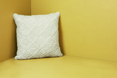 Elegant, tactile and pretty, crocheted cushions give a nostalgic, romantic feel to a room, while white looks fresh for summer. Priced at £12.