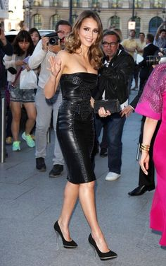 Jessica Alba wearing a leather Versace dress, attends the Versace Fashion Show
