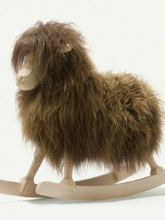 Rocking Sheep. Did someone really take the fur from a real animal and glue/sew it onto a fake one? Incredible.