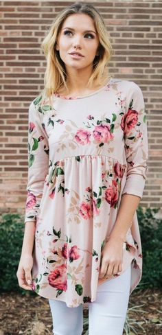 Beautiful blush floral print babydoll style top. Perfect pattern that'll take you into spring. Made in the USA