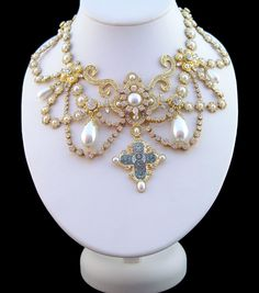 The Dagmar Necklace ~  In 1863 the Princess Alexandra of Schlewig-Holstein-Gluckburg's father was elected heir to the childless King Fredrick VII of Denmark.  For the marriage to the Prince of Wales that same year, the King had a famous jeweller in Copenhagen, design a necklace in the Byzantine style. It had 118 pearls and 2000 diamonds