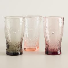 Adorn your tabletop with our hand-embossed floral drink tumblers or footed wine goblets in three color options. Full of romantic design, each piece gradually darkens toward the bottom, showcasing your drink in style.