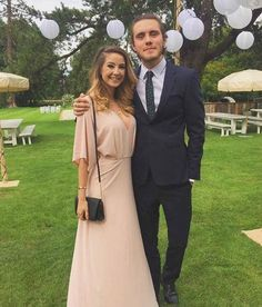 Alfie Deyes and Zoe Sugg at the Tanya Burr and Jim Chapman's wedding in September 2015...