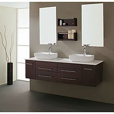 Bathroom double vanity is crafted with a distinctive modern designArtistic furniture is crafted of solid rubber wood with soft close hardwareBathroom furniture features an espresso finish and silvertone hardware