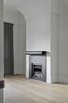 Fireplace by B.E Architecture with modern reinterpretation of period detailing for the Winter Street Residence