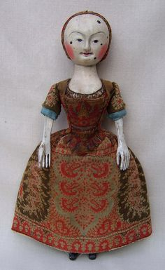 """Work of David Chapman & Paul Robinson of the """"Old Pretender"""" wooden doll workshop."""