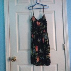 Black and floral rue 21 dress New never woren. No problems with it. Rue 21 Dresses