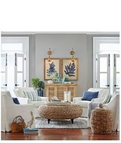 Tropical Family Room | A great example of how fresh and crisp blue and white can be with a wonderful window seat and lots of blue and white pillows. #Florida #LivingRoom