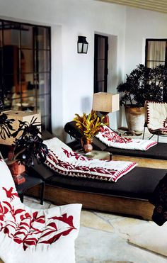 These graphic cushions, found on an Ibiza shopping trip, give big style to a small porch in photographer Mario Testino's 1930s Spanish style Hollywood Hills home. Photos by Mario Testino for Vogue, March 2012.