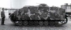 A Stug 4 with scherzen and very a intricate camouflage pattern.