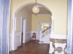 old house. 1856. chandeliers, shutters, arched doorways,wood floor - eye candy