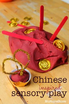 Chinese New Year sensory play Chinese spice play dough.what could we provide alongside dough to spark conversation around chinese culture and artefacts?