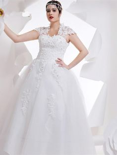 Plus size brides normally choose some type of sleeve on their wedding gown.  This lace cap sleeve design has a beaded lace bodice as well.  The a-line style full skirt gown bellows.  When you have custom #weddinggowns made by our US firm we can make any change you need to a design.  We can also provide to brides a replica gown for less than the original.  Contact us for pricing