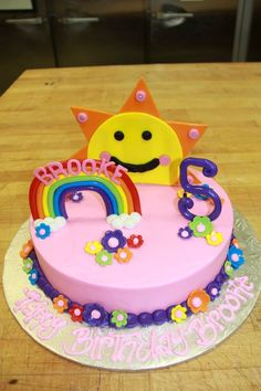 Sunshine and rainbows birthday cake