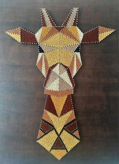 Giraffe: 420 meters of thread used Gütermann (3 variations of Brown, yellow ochre, mustard yellow and black) and 920 silver spikes nailed to painted wood Rustic style Board. Size: 95cm by 85cm Price: 180 euros.