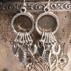 Besides looking super cool, these Lucky Charm Earrings are packed with symbolic meaning. Here is a breakdown of what you would be symbolically adorning yourself with by slipping on these little beauties.The Wishbone Charm is a symbol of the promise of good luck. If the Wishbone is unbroken, it symbolizes ...