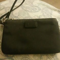 Coach wristlet Black color, in very good condition Coach Bags Clutches & Wristlets