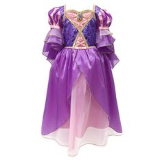 Let your down hair while wearing our radiant Rapunzel costume. Beautifully detailed with satin, foil filigree, and a bejeweled golden cameo, this resplendent gown will ensure fairytale dreams really do come true.