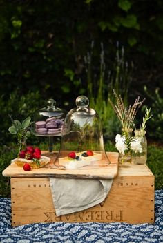 Try using an old crate as a makeshift table...you can even use it as a basket to carry everything