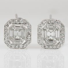 Emerald cut diamond stud earrings - Glorious stud earring for a tailored and refined look.  Emerald cut diamonds are seamlessly surrounded by trapezoid cut diamonds for a big look with approximately .99 carats total weight of diamonds set in 18K white gold.  Stunning!