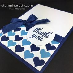 Lines of dark and light blue hearts make the white space on the top look good. Tie on a dark blue ribbon with a blue stamped sentiment for this handmade thank you card.