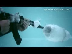 Hey, if you are going to try to shoot an AK-47 underwater, you better bring with you a video camera that can shoot in super slow motion mode. Well, the guy