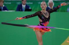 Belarus' Melitina Staniouta competes in the individual all-around qualifying event of the Rhythmic Gymnastics at the Olympic Arena during the Rio 2016 Olympic Games in Rio de Janeiro on August 19, 2016. / AFP / Thomas COEX