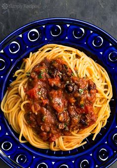Easy Pasta Puttanesca by simplyrecipes:  A classic Italian pasta sauce based on pantry items such as olives, capers, anchovies and canned tomatoes. Perfect for a quick weeknight dinner. #Pasta_Puttanesca #EAsy