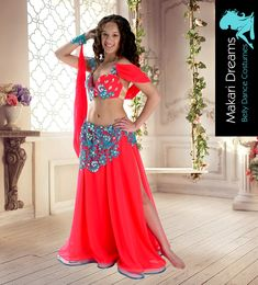 Belly dance costume by Makari Dreams. Amazing circle skirt made with high fashion fluorescent red chiffon, of the best quality. Turquoise lace decorated with big top quality glass crystals. www.makaridreams.com