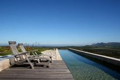 Length pool at eco-retreat Farm South Africa. Amazing Swimming Pools, Cool Pools, Relaxing Holidays, Hotels And Resorts, Luxury Travel, Outdoor Spaces, The Good Place, Outdoor Furniture Sets, Remote