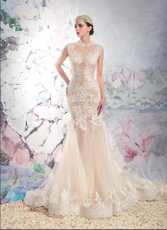 Style #1637L is one of our favourite mermaid gowns with lace illusion and tulle skirt! #weddingdress #bridalfashion