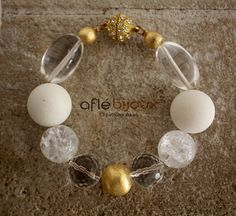 Magnificent bracelet made of white coral, smached cristal, smoth cristals, Akan gold weight. #aflebijoux #bijoux #jewelry #etsy