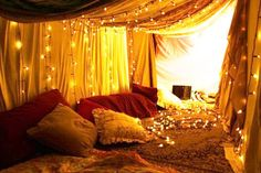 Tent with lights and pillows
