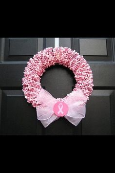 I saw this as someone's photo on Facebook. Looks like beaded necklaces super cute for Breast Cancer Awareness