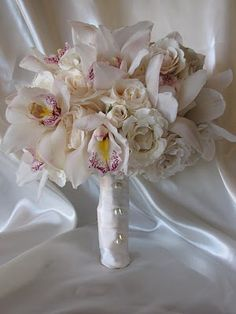 Roses and cymbidium orchid bouquet