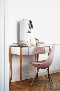 """[i]An elegant dressing table with mirrored surfaces makes the corner of this room feel spacious.[/i]  Like this? Then you'll love  [link url=""""http://www.houseandgarden.co.uk/interiors/furnishings/desks-and-dressing-tables""""]Do The Write Thing[/link]"""