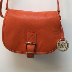 Michael Kors cross body/purse priced to sell  Orange cross body purse. NWOT. Comes with dust cover. 8.5in along the bottom and 9in from top to bottom. Please make me an offer. Priced to sell Michael Kors Bags Crossbody Bags