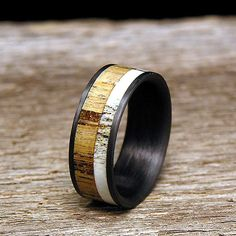 Jack Daniels Barrel Wood Carbon Fiber Wedding Band by HolzRingShop, $200.00 this would be cool for my brother if he gets married again...